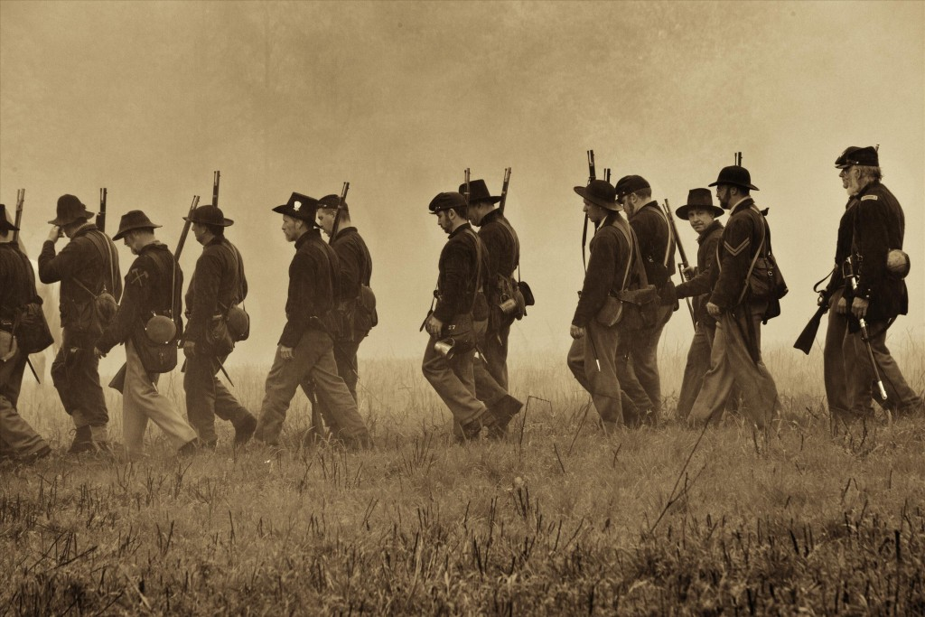 U.S. infantry reenactors on the march to the Piper house at Antietam